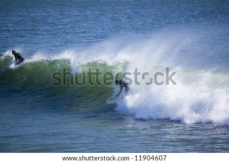 surfers on a wave