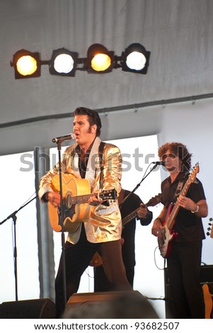 "SURFERS PARADISE - JAN 7 Mr. Mark Anthony  singer / performer on the stage  during the concert  ""Surfers Paradise Elvis Birthday Bash"" Saturday 7  2011 Surfers Paradise Queensland Australia . - stock photo"