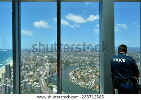 SURFERS PARADISE - NOV 14 2014:Police officer patrols in Skypoint observation deck.Gold Coast police on high terror alert warned to be hyper vigilant and patrol local critical infrastructure sites - stock photo