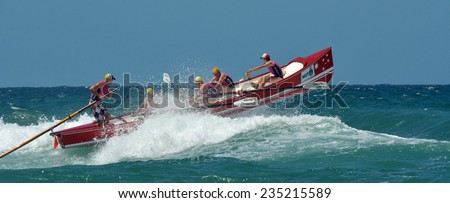 SURFERS PARADISE - NOV 08 2014:Surf rowers.More than 400 surf rowers and 55 surfboats hit the waves at Surfers Paradise Beach during the open Navy Australian Surf Rowers League season. - stock photo