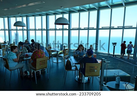 SURFERS PARADISE - NOV 14 2014:Visitors in Skypoint observation deck.It located 230 metres (750 ft) off the ground at the top of the Q1 on the Gold Coast, Australia.