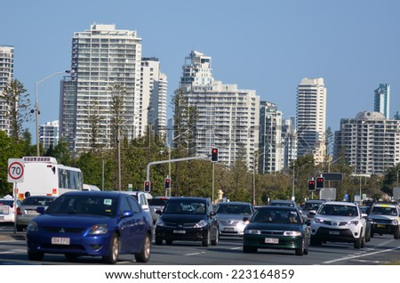SURFERS PARADISE - SEP 30 2014:Heavy traffic in Surfers Paradise.It one of Australia's iconic coastal tourist destinations, drawing about 10 million tourists every year from all over the world. - stock photo
