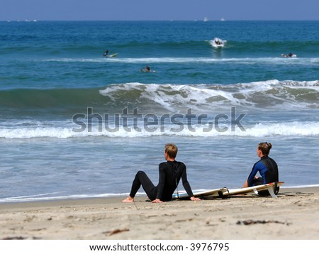Surfers Take A Break In Southern California - stock photo