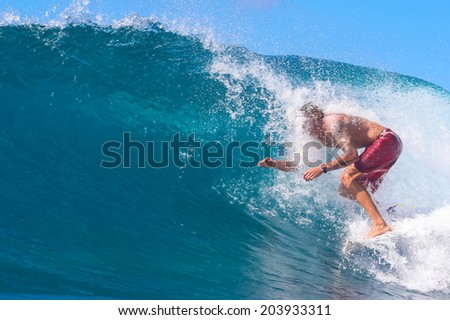 Surfing a Wave. Lombok Island. Indonesia. - stock photo