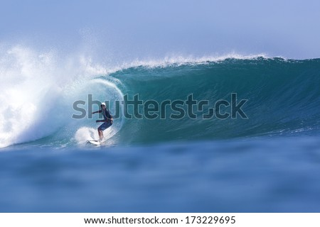 surfing a wavr  - stock photo