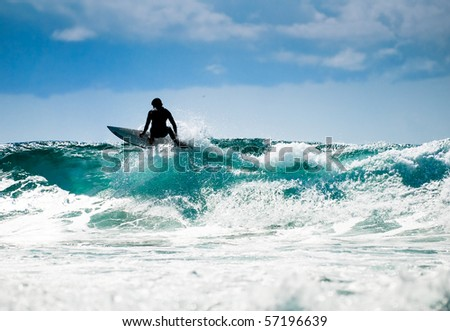 Surfing in nice  weather with great waves and blue skyline. - stock photo