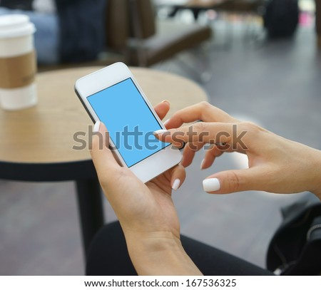 surfing internet with mobile phone  in a cafe - stock photo