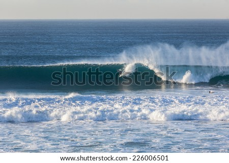 Surfing Ocean Wave Surfing surfer catching and riding good size hollow powerful  ocean wave