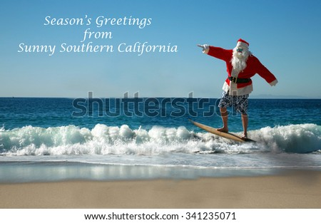 Surfing Santa. Santa Claus Surfs on his Surf Board while on a Beautiful Beach with a Blue Ocean. Focus on Santa/s Face. Santa Vacation. Surfing Santa. Santa goes Surfing.  - stock photo