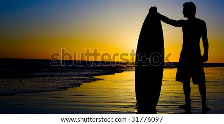 Surfing Silhouette - stock photo
