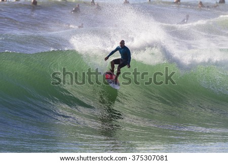 Surfing Surfer Action  Durban,South Africa - Feb 6, 2016:Surfing surfer summer morning wave action,