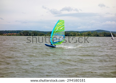 Surfing / Surfer at the Altmuehlsee, Bavaria, Germany - stock photo