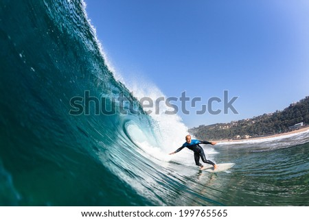 Surfing Surfer Rides Wave Water Action Surfing surfer rides blue ocean wave, swimming closeup action water photo - stock photo