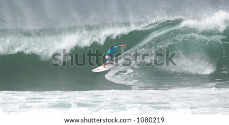 Surfing the Bonzai Pipeline surf break on Oahu's North shore. (image contains noise) - stock photo