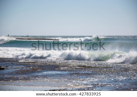 Surfing the Indian Ocean at Jake's Point in Kalbarri,Western Australia/Wave Surfing/KALBARRI,WA,AUSTRALIA-APRIL 20,2016: Surfer at Jake's Point surfing the Indian Ocean in Kalbarri, Western Australia