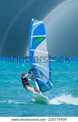 Surfing Under The Rainbow - stock photo