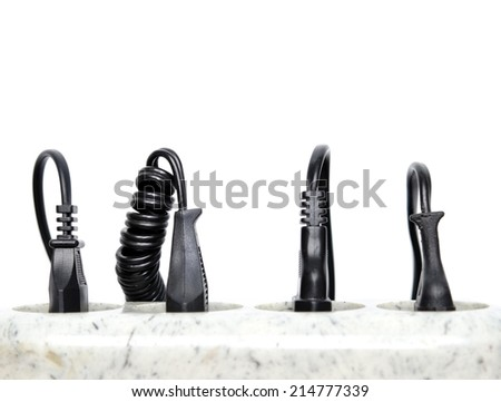 Surge protector and wires on a white background - stock photo