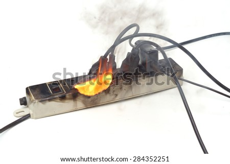 Surge protector caught on fire due to overheat - stock photo