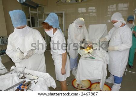 surgeon team in operative room - stock photo