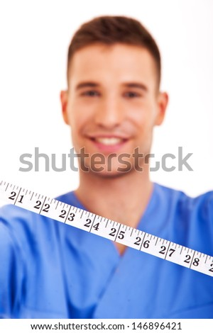 Surgeon with centimeter over white background  - stock photo