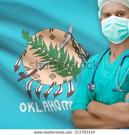 Surgeon with USA states flags on background - Oklahoma - stock photo