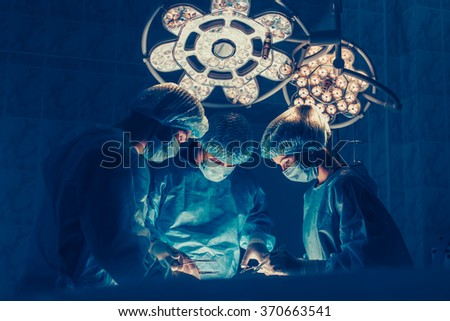 Surgeons team working with Monitoring of patient in surgical ope - stock photo