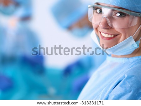 Surgery team in the operating room - stock photo