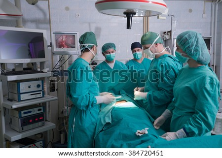 Surgery team operating in a surgical room - stock photo