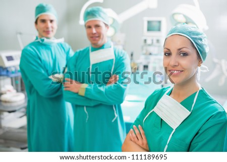 Surgical team with arms crossed in an operating theater