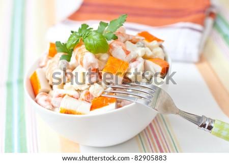 surimi and prawn salad with potato and sauce - stock photo