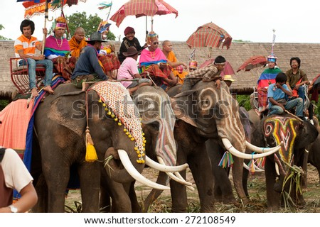 SURIN,THAILAND-MAY 23 : Ordination Parade on Elephant�s Back Festival is when elephants parade and carry Novice monk on their backs at  Wat Chang Sawang to Moon river on May 23,2013 in Surin,Thailand.