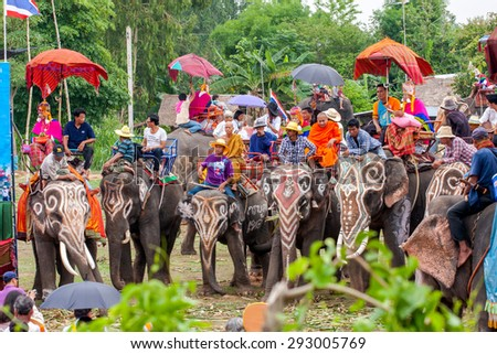 SURIN, THAILAND - MAY16:Ordination Parade on Elephant's Back Festival is when elephants parade and carry Novice monk on their backs at Wat Chang Sawang to Moon river on May16, 2011 in Surin, Thailand.