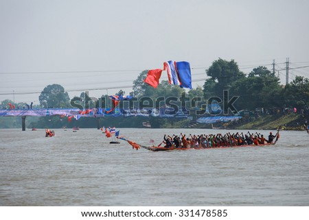 SURIN THAILAND-OCT-24: Unidentified action rowers in Climbing Bows toward Snatching a Flag native Thai long boats compete during Native Long Boat Race Championship on OCT 24, 2015 in SURIN, Thailand.