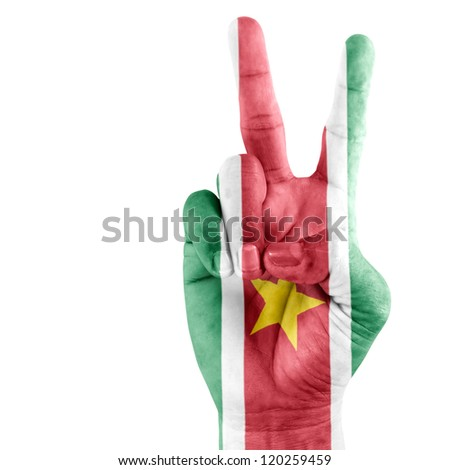 Suriname flag  on victory hand with a white background. - stock photo