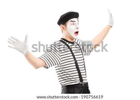 Surpised mime artist gesturing with hands, isolated on white background - stock photo