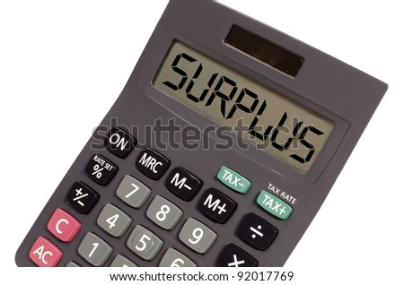 surplus written on display of an old calculator on white background in perspective - stock photo