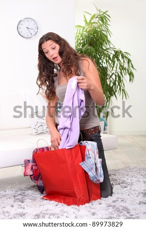 surprise after shopping - stock photo
