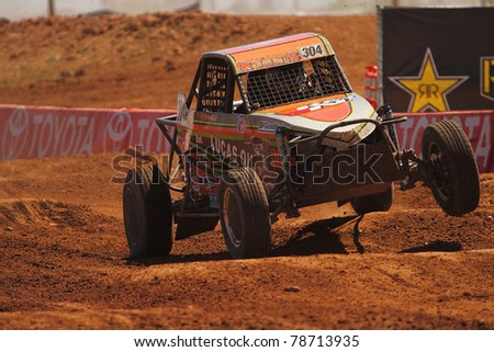 SURPRISE, AZ - APR 16: Bradley Morris (304) at speed in round 3 action of Lucas Oil Off Road Series Limited Buggy racing on April 16, 2011 at Speedworld Off Road Park in Surprise, AZ. - stock photo