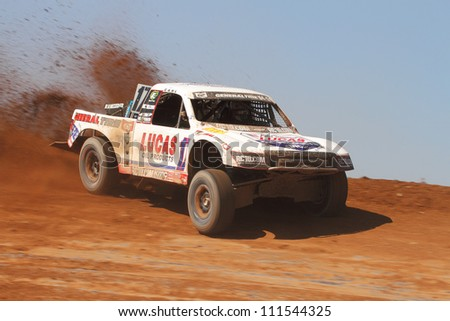 SURPRISE, AZ - APR 16: Carl Renezeder (17) at speed in Pro 4 Unlimited Lucas Oil Off Road Series racing on April 16, 2011 at Speedworld Off Road Park in Surprise, AZ. - stock photo