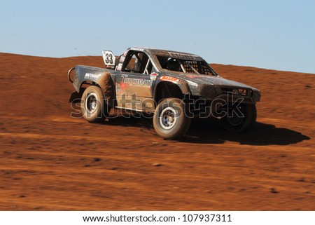 SURPRISE, AZ - APR 16: CJ Greaves (33) at speed in Super Lite Class Lucas Oil Off Road Series racing on April 16, 2011 at Speedworld Off Road Park in Surprise, AZ. - stock photo