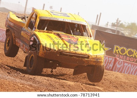 SURPRISE, AZ - APR 16: Jerry Daugherty (23) at speed in Pro 4 Unlimited Lucas Oil Off Road Series racing on April 16, 2011 at Speedworld Off Road Park in Surprise, AZ. - stock photo
