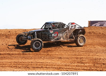 SURPRISE, AZ - APR 16: Steven Greinke (23) at speed in Pro Buggy Unlimited Lucas Oil Off Road Series racing on April 16, 2011 at Speedworld Off Road Park in Surprise, AZ. - stock photo