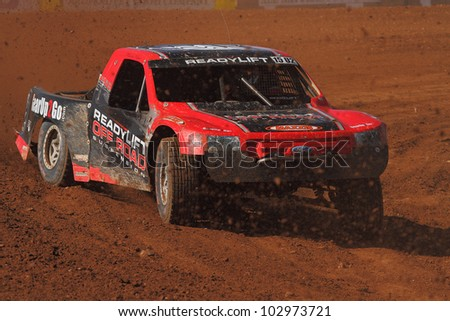 SURPRISE, AZ - MAY 18: Marty Hart (15) at speed in Lucas Oil Off Road Series racing Pro 2 Unlimited qualifying on May 18, 2012 at Speedworld Off Road Park in Surprise, AZ. - stock photo