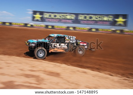 SURPRISE, AZ - SEP 23: Curt LeDuc (43) at speed in Pro 4 Unlimited Lucas Oil Off Road Series practice on Sept. 23, 2011 at Speedworld Off Road Park in Surprise, AZ.  - stock photo