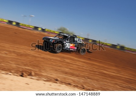 SURPRISE, AZ - SEP 23: Doug Fortin (8) at speed in Pro 4 Unlimited Lucas Oil Off Road Series practice on Sept. 23, 2011 at Speedworld Off Road Park in Surprise, AZ.  - stock photo