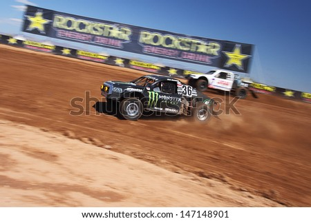 SURPRISE, AZ - SEP 23: Rick Huseman (36) at speed in Pro 4 Unlimited Lucas Oil Off Road Series practice on Sept. 23, 2011 at Speedworld Off Road Park in Surprise, AZ.  - stock photo