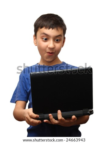 surprise boy with laptop - stock photo