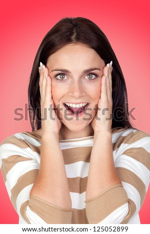 Surprise brunette girl with a red background - stock photo