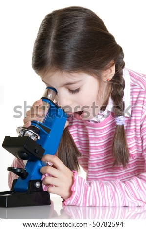 surprise child found some ting with microscope - stock photo