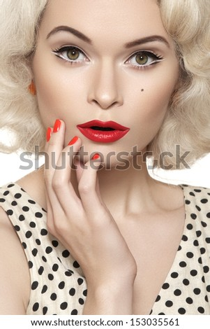 Surprise! Portrait of beautiful young sexy woman with vintage make-up and hairstyle. Pin-up girl. American style  - stock photo